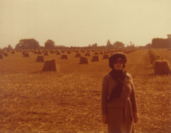 Madeline with haystacks in France
